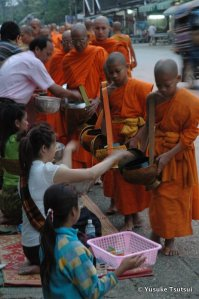 Morning procession of monks receiving alms